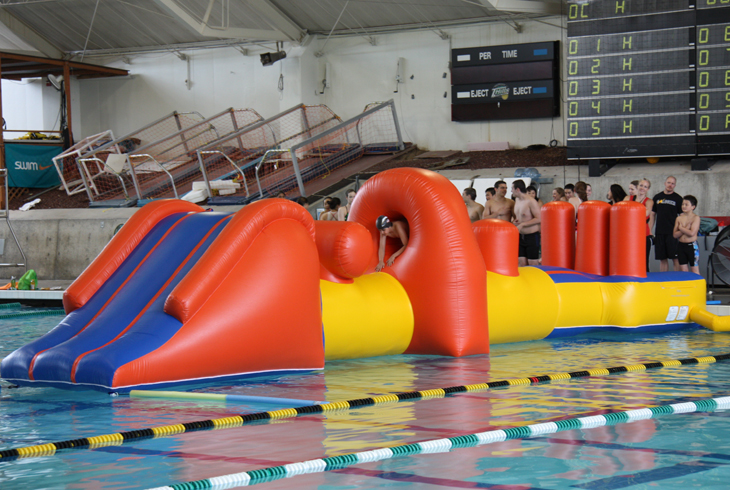 The Aqua Challenge makes the rounds at district pools on a rotating schedule. The challenge is navigating the obstacle course without falling in the water.