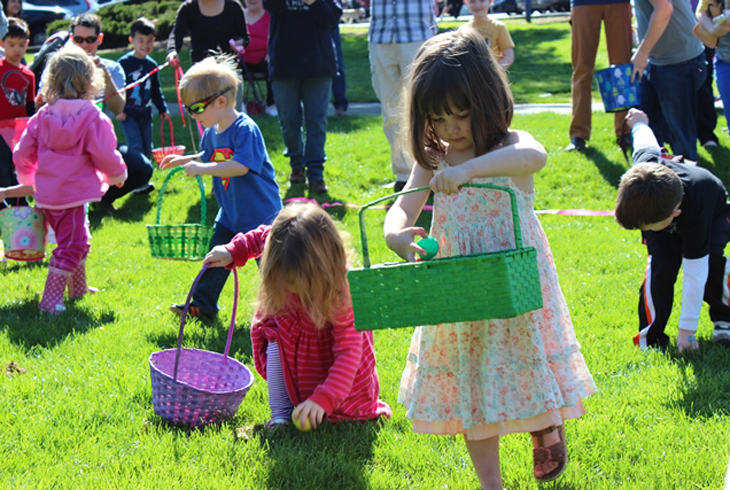 Kids (ages 1 to 10) swarm the field behind Garden Home Recreation Center in search of eggs at the annual Spring Egg Hunt.