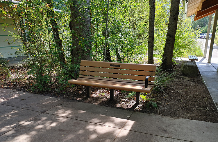 Tualatin Hills Nature Park bench with an embedded memorial plaque