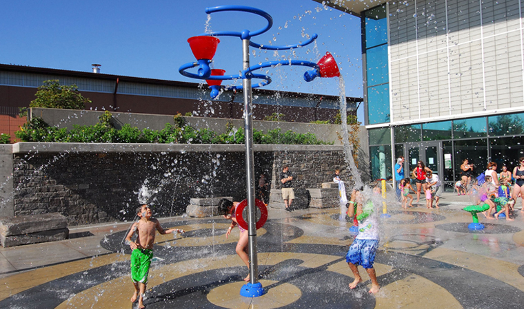 Signs of Summer - Conestoga's splash pad is open